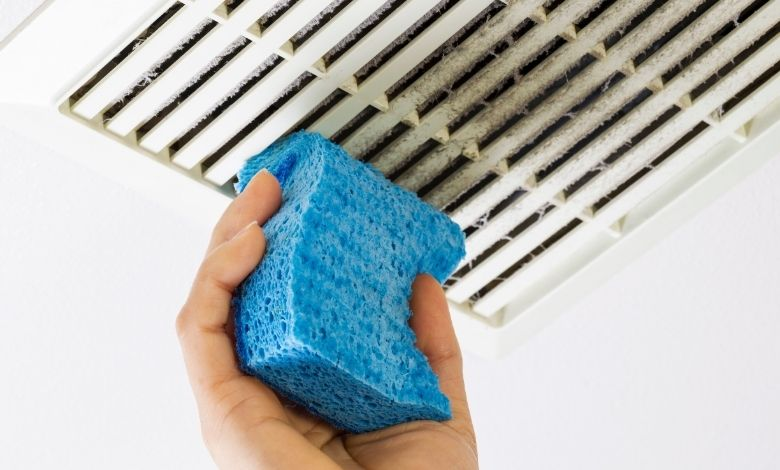 cleaning bathroom extractor fan