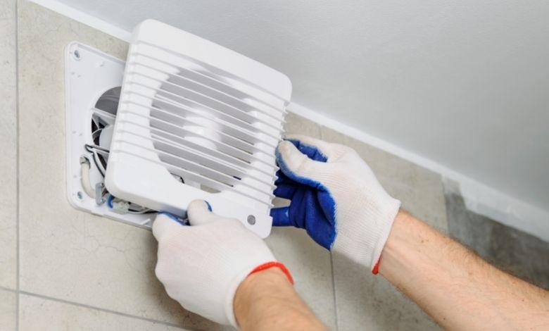 man replacing bathroom fan